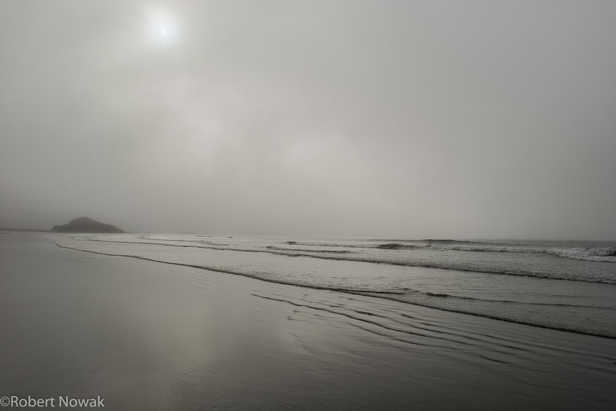 Sun penetrating dense fog in the Schooner Cove area of Pacific Rim National Park.