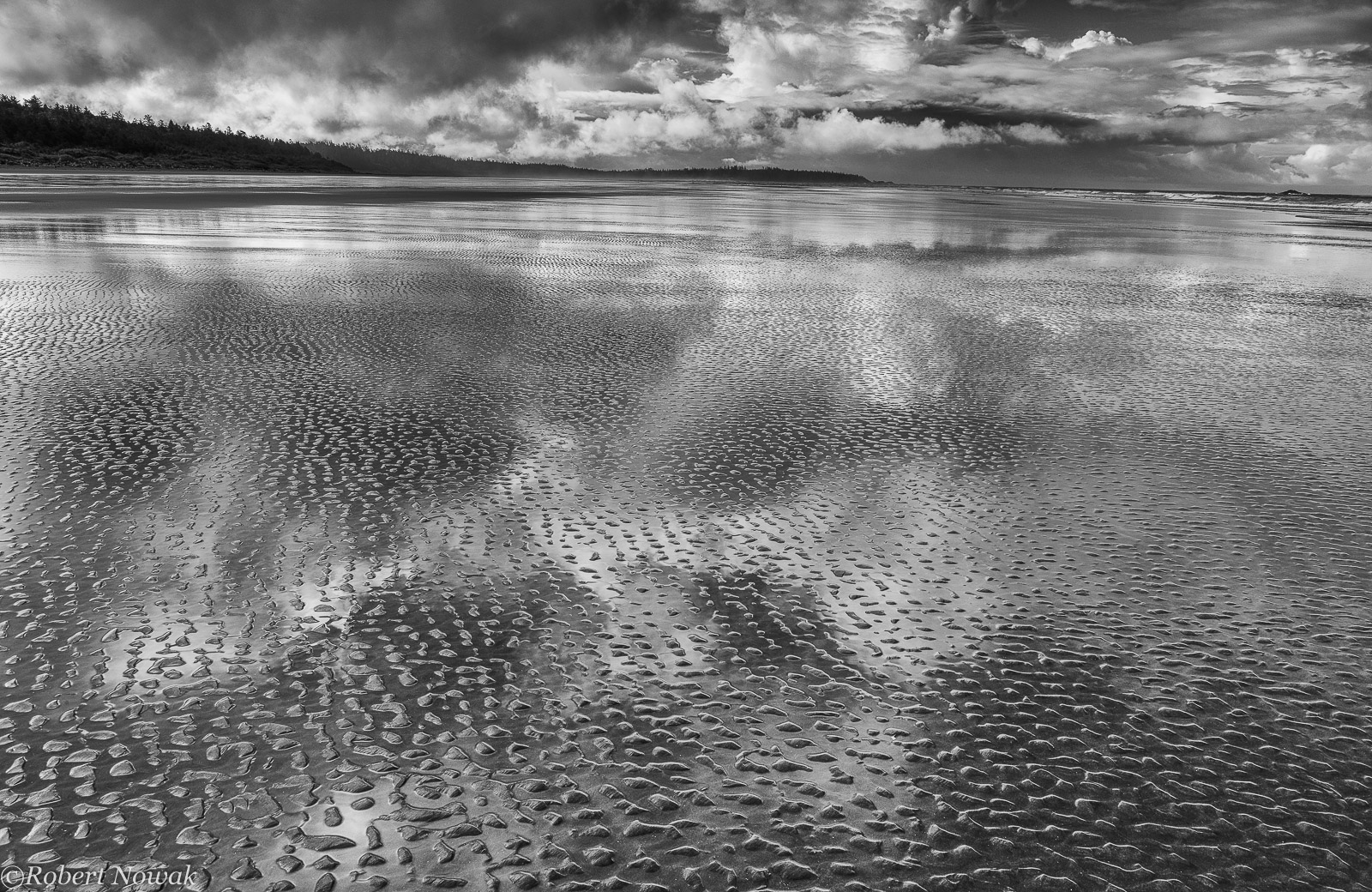 Sky reflection and sand ripples on Combers Beach